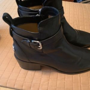 Black leather booties by Coach